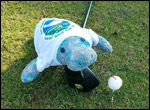 Charlee the manatee at the charity golf tournament.